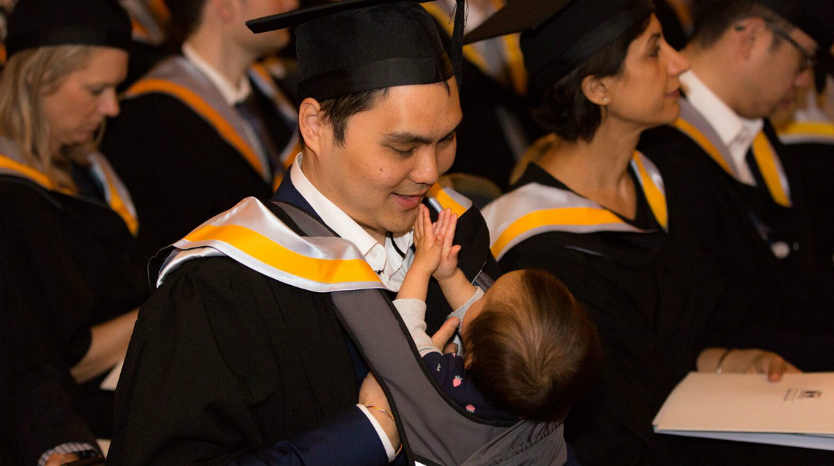 Melbourne Business School graduate Joel Ng and his daughter Arielle